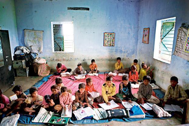 Photo Credit; Livemint.com As there are no proper classrooms, classes are conducted at every available space at the Kavalkaranpatty Government High School in Karur district. Photo: B.Velankanni Raj