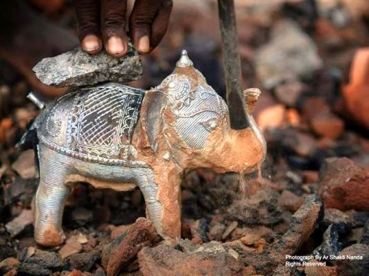 The art forms of Odisha: yet another place of art work, in my home district, I didn't know there are so many. Just out of furnace Dhokra metal casting craft at Nabajaubanpur, Dhenkanal. Photo credits: Ar Shakti Nanda