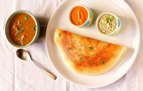 A variant of dosa and a daily breakfast option in Odisha.  9.CHAKULI PITHA Chakuli Pitha is a notable dish of Odisha with a delectable crisp ! It is a rice based fried flat pancake ! It is similar to South Indian dish Dosa ! This is also a great option for those looking to rake in their daily dose of calcium !