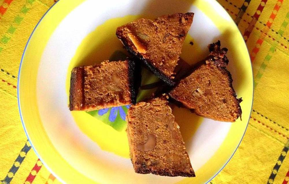 Another favorite of mine.  3.PODA PITHA Poda is basically a rice cake that tingles your taste bud. It's crust are slightly burnt, while the inside is soft and white. It is must prepared dish during the festive of Raja .