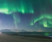 The northern light or aurora is an electromagnetic phenomenon, produced due to motion of charged cosmic particles entering earth's magnetic field.